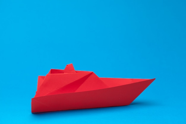 Winner red paper ship