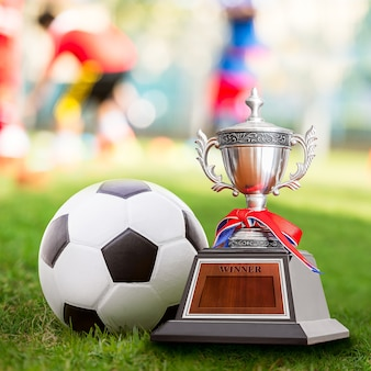 Winner trophy and soccer ball at the competition sport court