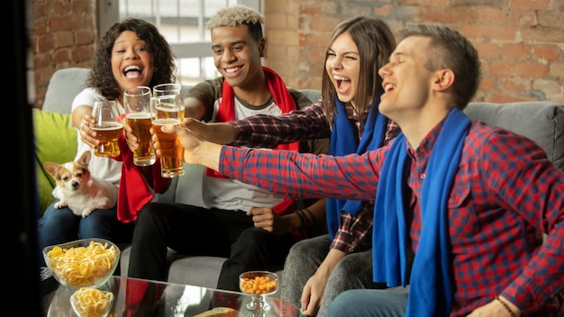 Winners. excited people watching sport match, championship at home. multiethnic group of friend, fans cheering for favourite national basketball, tennis, soccer, hockey team. concept of emotions.