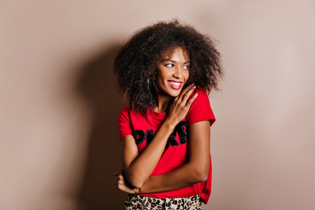 Winsome woman with cheerful smile posing in studio