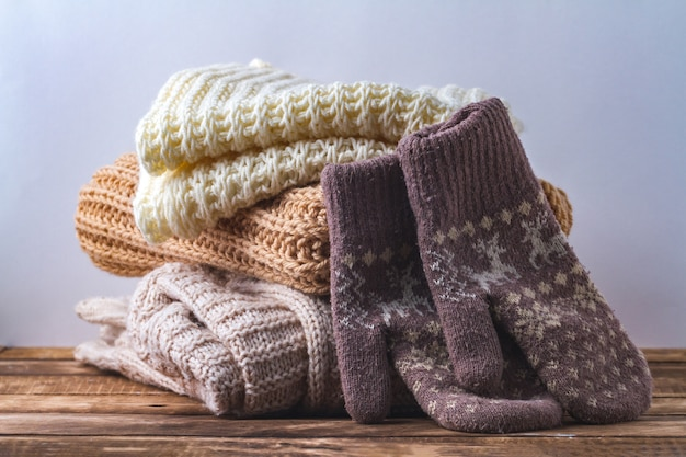 Winter, autumn clothes, knitted scarves and warm mittens