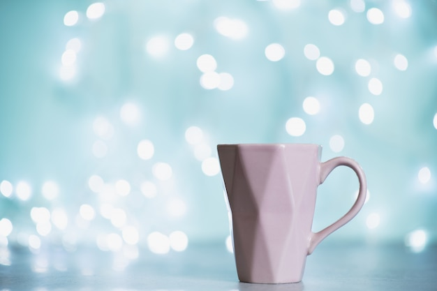 Winter background with hot drink with marshmallows
