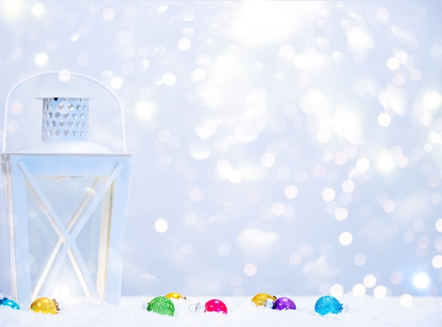 Winter background with lantern lamp, christmas balls and copy space.