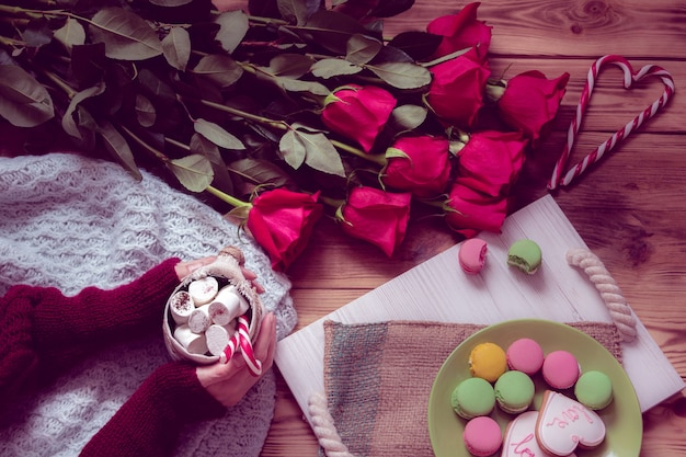 Winter breakfast with red rose and heart of striped lollipop