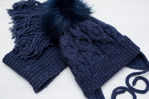 Winter children's knitted hat and scarf in blue