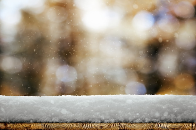 A winter christmas background with snow on the wood