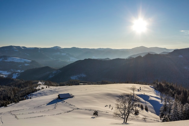 Winter christmas landscape of mountain valley on frosty sunny day.