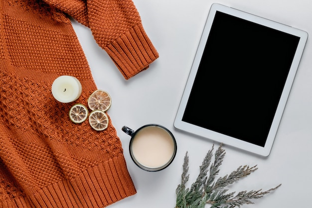 Winter composition. candles, sweater, oranges. still life lifestyle. autumn concept. flat lay, top view, copy space.