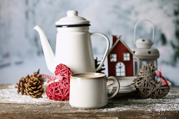 Winter composition with hot beverage on nature