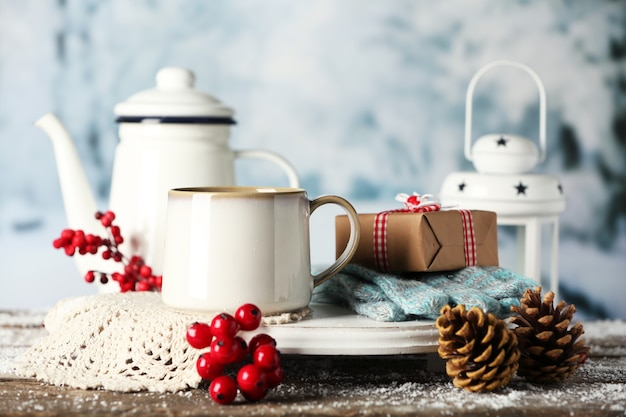 Winter composition with hot beverage