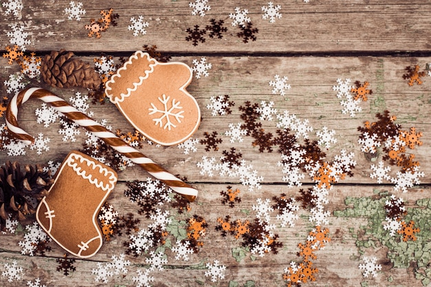 Winter composition with lollipop, gingerbread cookies and pine cones