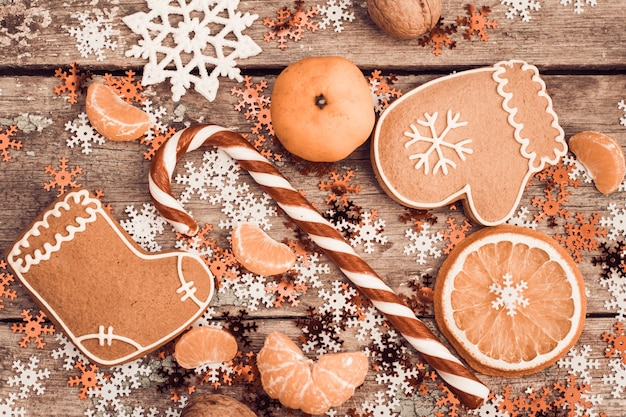 Winter composition with lollipop, gingerbread cookies