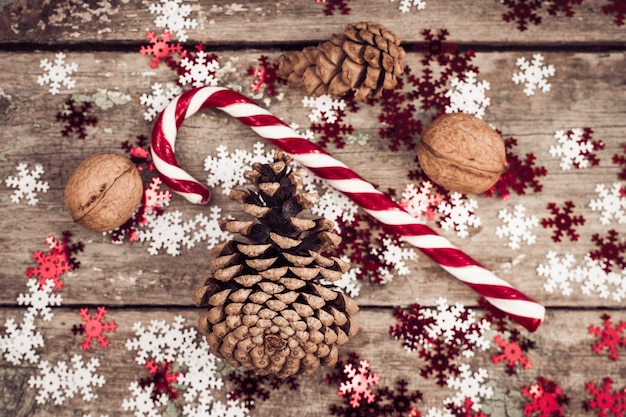 Winter composition with pine cones, walnuts and lollipop