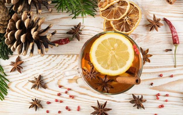 Winter drink with spices on wooden table
