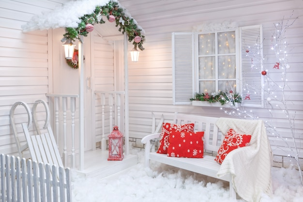 Winter exterior of a country house with christmas decorations.
