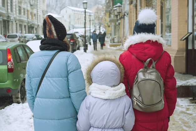 Winter family walk in the city