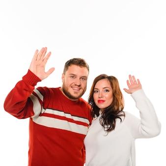 Winter fashion models waving at camera