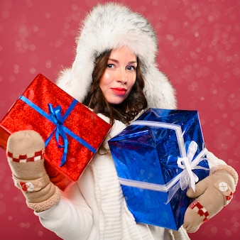 Winter female model holding presents
