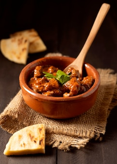 Winter food stew in bowl with pita bread