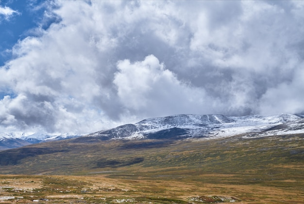 Winter has come to the siberian steppe, snow-capped mountain peaks