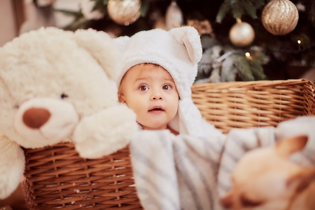 Winter holidays decorations. baby-girl portrait. charming little girl in funny white ears