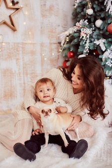 Winter holidays decorations. Warm colors. Family portrait. Adorable mom and daughter