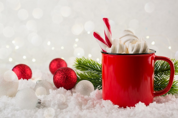 Winter hot drink, cacao with marshmallows or spicy hot chocolate in red cup. festive vintage