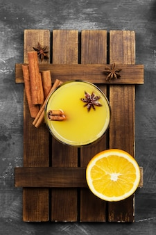 Winter hot drink from oranges and spices on black. food