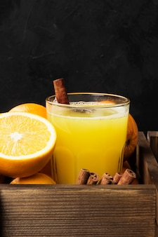 Winter hot drink from oranges and spices on black