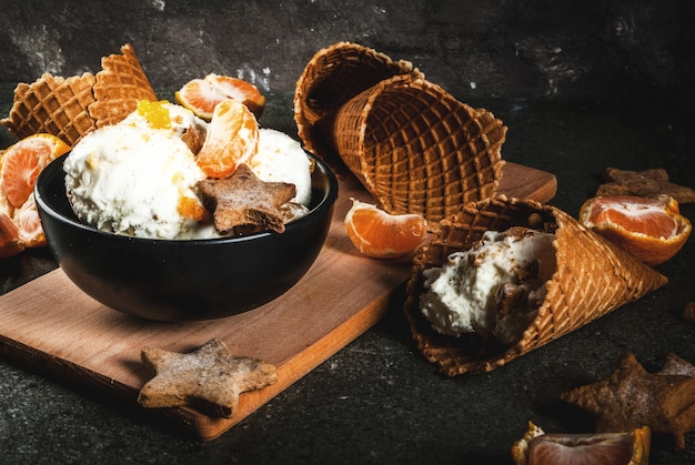 Winter ice cream with gingerbread and tangerines