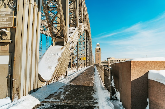 Winter landscape of bolsheokhtinsky bridge in st. petersburg on a sunny snowy day