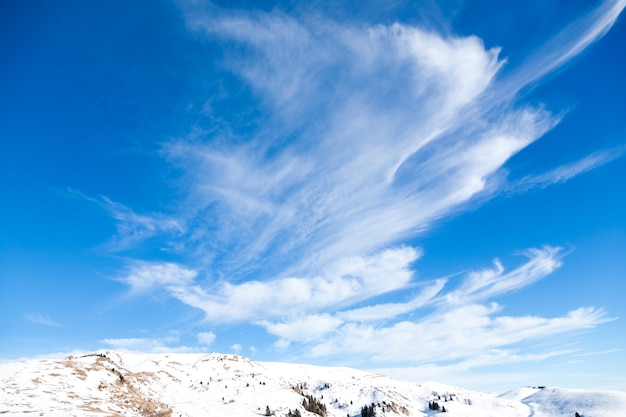 Winter landscape from italian alps. beautiful clouds on blue sky. white snow