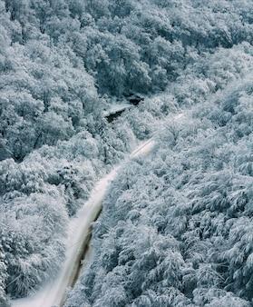Winter landscape mountain road in forest