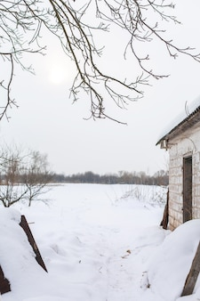 Winter landscape in the village. view of the snowy field