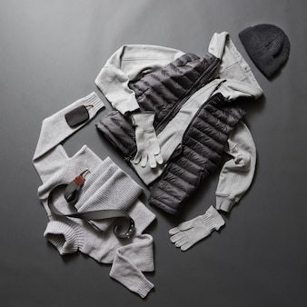 Winter men's clothes and accessories on a black surface