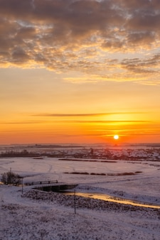Winter morning with the sun on the horizon