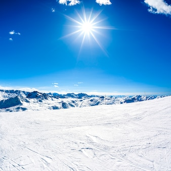 Winter mountain landscape with sun