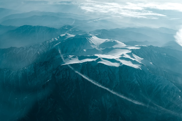 A winter mountain view from plane window