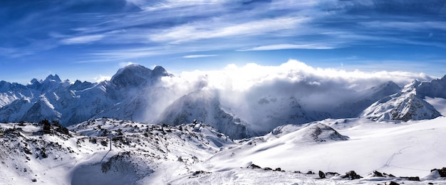 Winter mountains landscape with blue sky in caucasus. panoramic view from elbrus