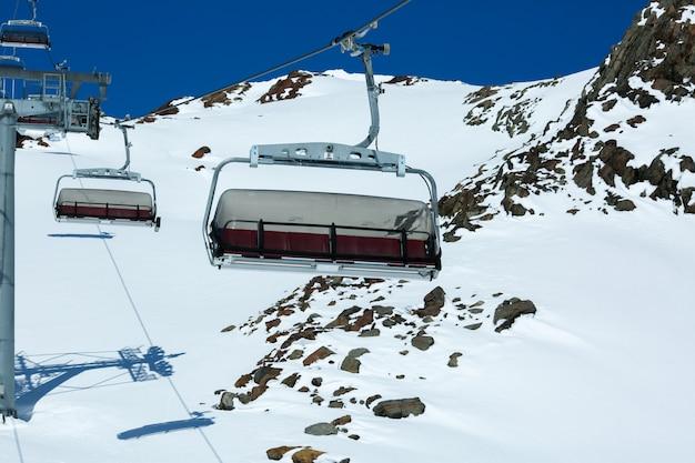 Winter mountains panorama with ski slopes and ski lifts. alps. austria. pitztaler gletscher. wildspitzbahn