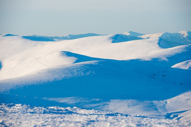 Winter mountains and white snow hills