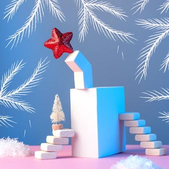 Winter new year's still life with stairs, christmas tree, star, sun, snow and geometric shapes
