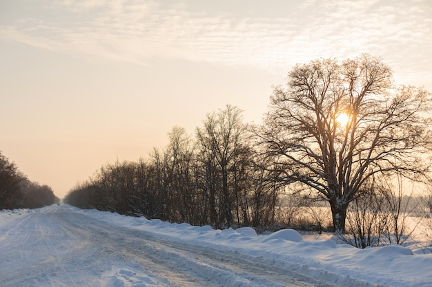 Winter poorly cleared road. road in the countryside strewn with snow. winter landscape with snowdrifts