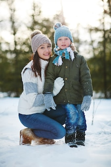 Winter portrait of mother and son