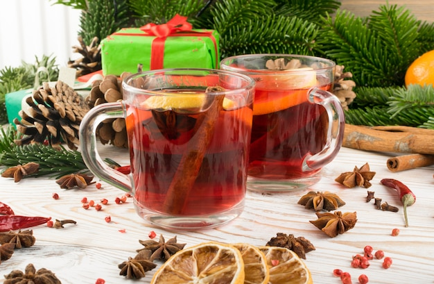 Winter red drink with spices on festive new year background