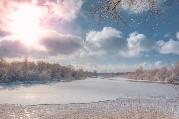 Winter river landscape on frosty day in nature