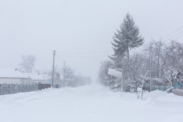 Winter, rural streets are covered with snow. snow blizzard.