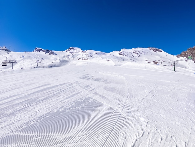 Winter skiing area on a glacier with a ski slope