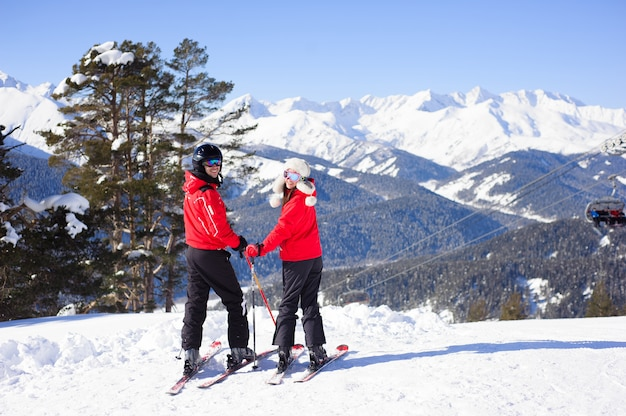 Winter, skiing - happy family in a ski resort.