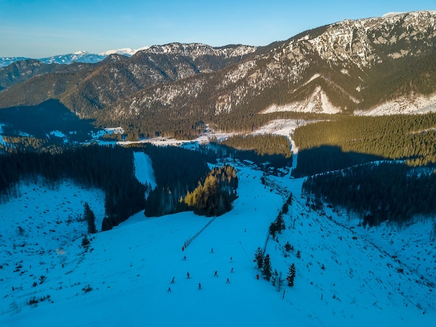 Winter slovakia. sunny day at the jasna ski resort. blue sky. mountain peaks and ski slopes. aerial view